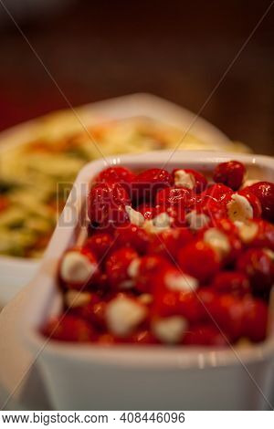 Hot Peppers With Creamy Cheese, Tapas, Spanish. High Quality Photo