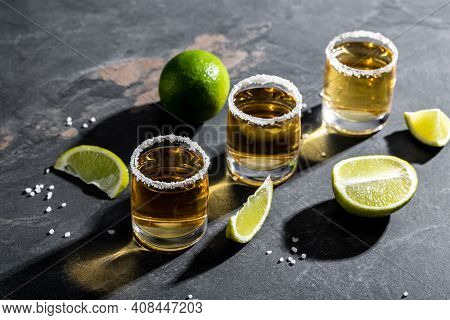 Tequila Shot With Lime And Sea Salt On Stone Background. Luxury Drink. Alcoholic Drink Concept. Mexi