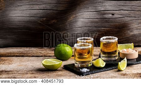 Shots With Mexican Tequila, Limes, Salt, Golden Tequila. Mexican National Drink. Long Banner Format.