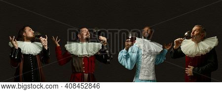 Enjoying Luxury Red Wine. Medieval Men As A Royalty Persons In Vintage Clothing On Dark Background.