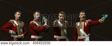 Gangster With Toy Gun. Medieval Man As A Royalty Person In Vintage Clothing On Dark Background. Conc