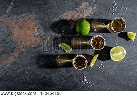 Mexican Tequila With Lime And Salt On Rustic Black Background. Space For Text. Luxury Drink. Alcohol
