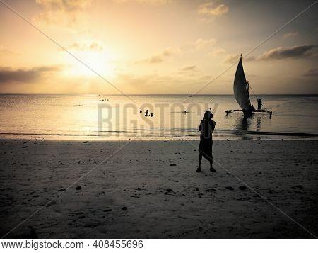 Sunset On The Beach, Beautiful Landscape On The Ocean Shore On Island Zanzibar