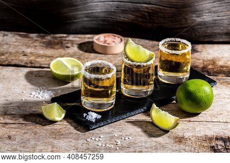 Three Tequila Shot Glasses With Salt And Lime Mexican National Drink. Golden Tequila Shots. Space Fo