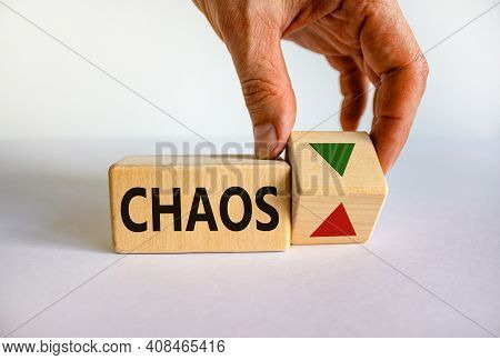 Time To Stop Chaos Symbol. Businessman Holds A Cubes With Up Icon. Wooden Cubes With Word 'chaos'. B