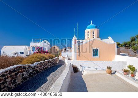 Famous greek church architecture in Oia town cityscape at Santorini island in Greece. Traditional white houses. Greece, Aegean sea. Famous European destination