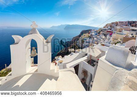 Famous view of Oia town cityscape at Santorini island in Greece. Traditional white houses. Greece, Aegean sea. Famous European destination