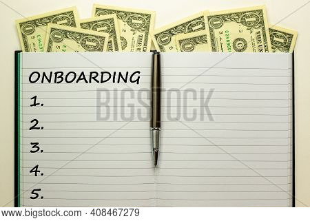 Onboarding Symbol. White Note With The Word 'onboarding' On Beautiful White Background, Metalic Pen,