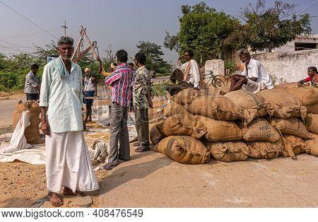 Ayodhya, Karnataka, India - November 9, 2013: Stack Of Brown Jute Bags With Freshly Harvested And We
