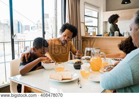 Portrait Of African American Family Having Breakfast