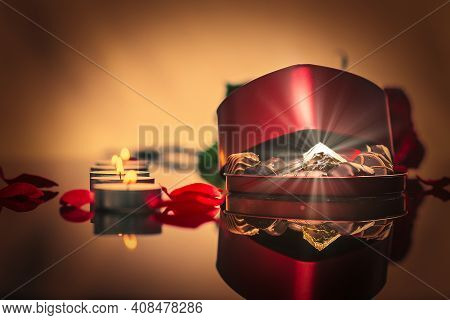 A Photographic Image Of A Brightly Glowing Gem In A Box Of Chocolates Heart Shape Against A Backgrou