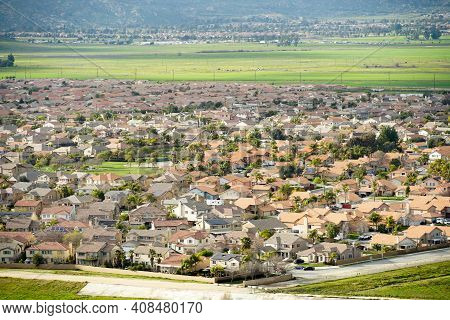 Aerial View Suburban Neighborhood With Identical Wealthy Villas Next To Each Other With Mountain Beh