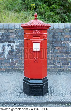 Red Post Box In City Centre Of Birmingham, United Kingdom. British Style Red Post Box. Traditional R