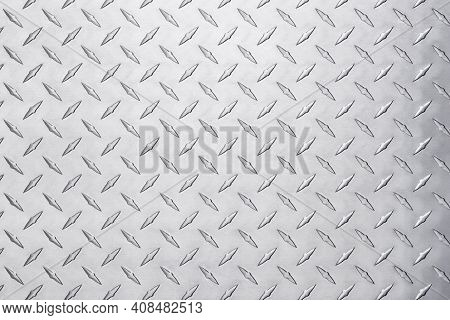 Shiny Metal Texture With Diamond Pattern. Stainless Steel Background. Industrial Metal Texture. Grun