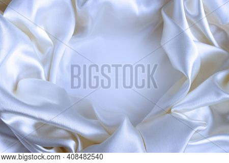 White Satin Material With Beautiful Pleats. Silk, Satin - Natural Fabric. Texture,
