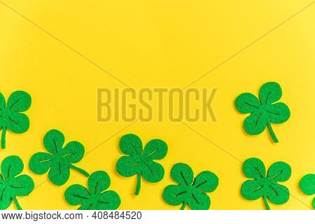 St Patricks Day Background. Simply Minimal Design With Green Shamrock. Clover Leaves Isolated On Yel