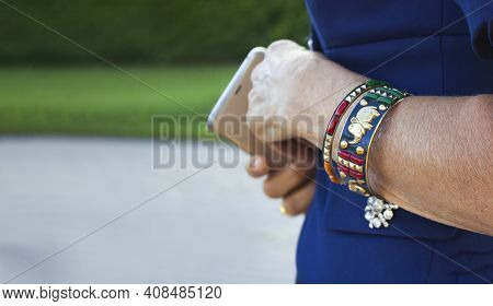 A Bracelet On The Arm Of A Mature Prestigious Lady Of 50-60s. Close-up Of A Hand With A Bracelet In