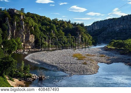The Rapid Current Of The Ardeche River In A Rocky Canyon In France