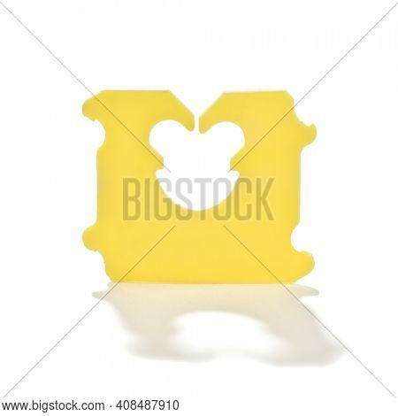 Close-up image of a plastic bread bag clip to hold plastic bags closed for sliced bread isolated on white background.