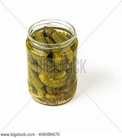 Delicious Pickled Cornichons In An Open Glass Jar Isolated On White Background. Whole Green Gherkins