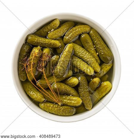 Delicious Pickled Cornichons In A Ceramic Bowl Isolated On White Background. Whole Green Gherkins Ma