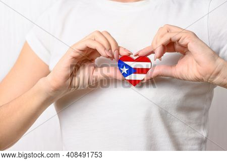Love Puerto Rico. The Girl Holds A Heart In The Form Of The Flag Of Puerto Rico On Her Chest. Puerto
