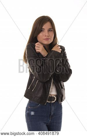 Upset Girl Stands And Clasped Her Hands Together. Girl With Upset Face Stands On White Background.