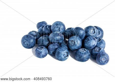 Ripe Tasty Juicy Blueberry Lies On An Isolated White Background.