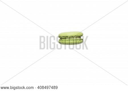 French Crash Macaroon. Green Macaroon Cake Isolated On A White Background, Sweet Dessert Levitation