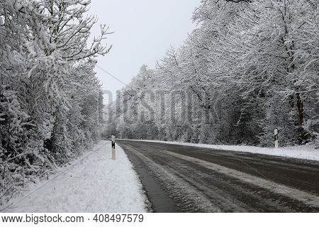 Snowy Road On A Clear Winter Day