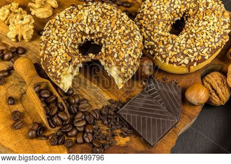Yummy Donuts With Sprinkles On Wooden Table, Flat Lay. Donuts And Coffee. Unhealthy Food. Risk Of Ob