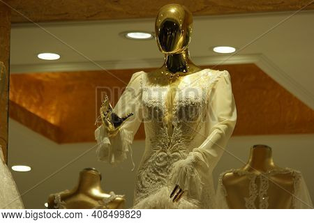 Mannequin In Stylish Wedding Dress At Boutique Store. Luxurious Bridal Dress On Mannequin In Wedding