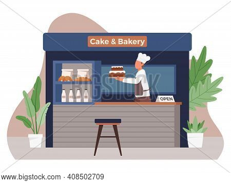 Small Business And Self-employment Concept With Male Chef Making Cakes. Male Baker Holding A Tray Wi