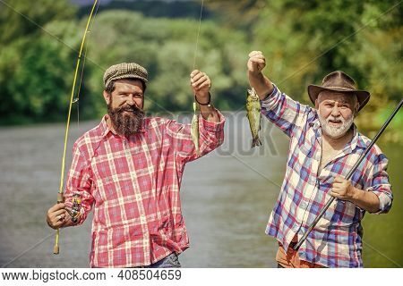 Reunited And It Feel So Good. Father And Son Fishing. Summer Weekend. Mature Men Fisher. Hobby And S
