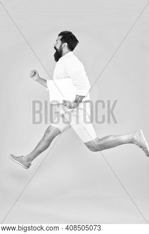 Mobile Is Lifestyle Not Technology. Energetic Hipster In Midair Yellow Background. Bearded Man Run W