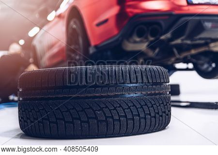 Changing Car Tire And Wheel In The Car Mechanical Service