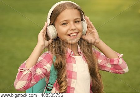 Audio Book Concept. Studying Audio Lessons. Listen Music While Walking. Girl Headphones Listening Mu