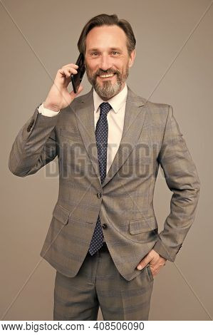 Mature Boss Talk On Phone. Man Holding Device And Smiling. Speak To Colleague. Technology Bring Succ