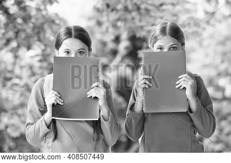 Get More Knowledge. Little Children Cover Faces With Books. Small Bookworms. Library Books. Fiction