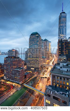 New York, New York, USA financial district cityscape over the West Side Highway at dusk.