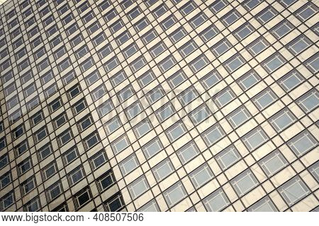 Beauty Of Rhythm. Skyscraper Modern City Architecture. Modern Building Architecture. Sky Reflects In