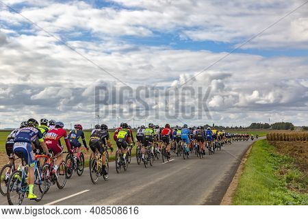 Le Gault-saint-denis, France - October 08, 2017: The Peloton Riding On A Road In The Plain With Wind