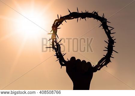 Hand Holding Crown Of Christ, Concept Of Resurrection Of Christ, Catholicism