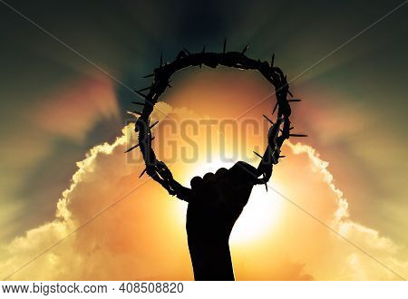 Hand Of Jesus Christ With Sky And Rising Sun, Holding Crown Of Thorns, Critsão Symbol Of Rebirth, Fa