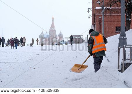 Moscow. Russia. February 12, 2021. A Male Utility Worker In Red Square Shovels Snow After A Heavy Sn