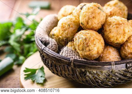 Dumpling Made Of Fried Rice, With Spices, Garlic And Salt. Croquette Typical Of Brazilian Cuisine