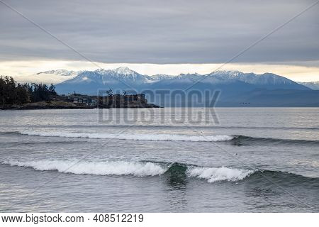 Waves And Mountain View From Whiffin Spit On Vancouver Island, British Columbia, Canada