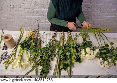 The Florist Creates A Floral Arrangement Of Roses, Lilacs, Callas, Carnations, Hydrangeas, Brasica,