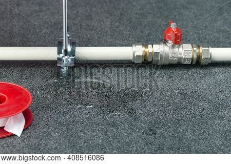 Water Leak On A Water Pipe. Repair Of Broken Pipe On Title Surface With Copy Space.