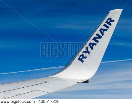 IN FLIGHT - CIRCA SEPTEMBER 2013: Ryanair airplane wing detail. Ryanair s an Irish low-cost airline founded in 1984.